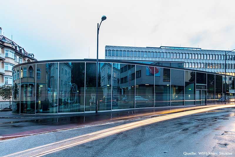 gebogene-glaeser-fassade-glasfassade-gebogen-wifi-salzburg-glasradius-esg-vsg-iso-fassadenradius